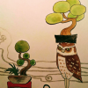 盆栽フクロウと遊ぶ